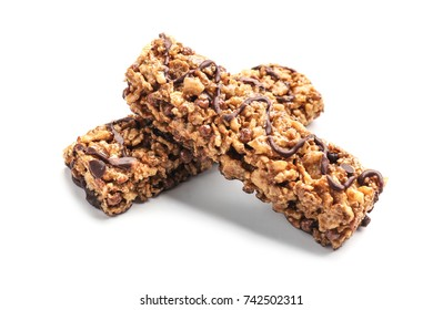 Healthy cereal bars with chocolate on white background