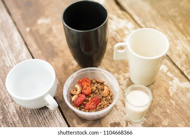 Healthy cereal in cup. Nutritious mixture of rolled oats, bran cereal and baked tomato in cup breakfast bowl. Nourishing healthy breakfast