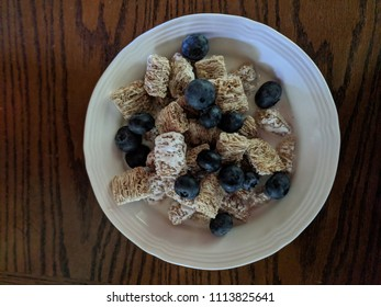 Healthy Cereal with milk and blueberries