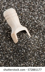 Healthy Chia seeds with wooden scoop