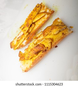 Healthy chicken breast sandwich cooked with turmeric on white background.