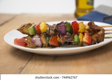 Healthy Chicken tikka kabab with vegetables outdoor with oil in background