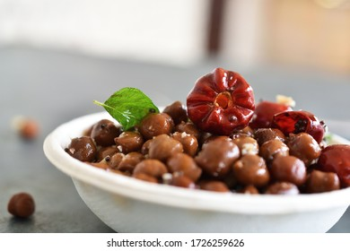 Healthy Chickpea Sundal  also know as Channa Sundal on the white paper cup