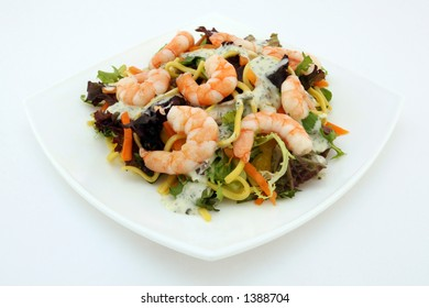 Healthy Chinese - Asian King prawn shrimp salad, consisting of noodles, peppers, lettuce and sauce on white, macro, closeup