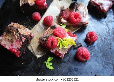 healthy chocolate brownie with fresh raspberries
