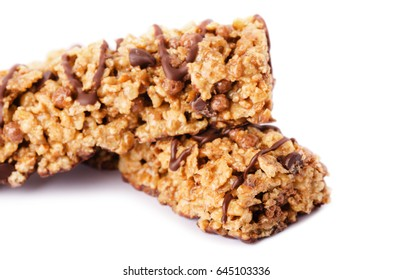 Healthy chocolate cereal bar munchies isolated on white background