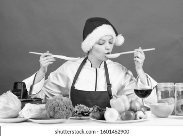 Healthy christmas holiday recipes. Festive menu concept. Woman chef santa hat cooking hold wooden spoons. Best christmas recipes. Christmas dinner idea. Try main meal. Easy ideas for christmas party.