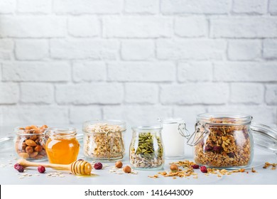 Healthy clean eating, dieting and nutrition, fitness, balanced food, breakfast concept. Homemade granola muesli with ingredients on a table. Copy space background
