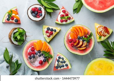 Healthy clean eating, dieting and nutrition, seasonal, summer breakfast concept. Fruit salad with yogurt in carved watermelon bowl on a kitchen table. Tropical top view flat lay background.