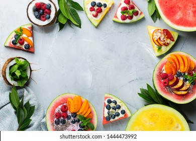 Healthy clean eating, dieting and nutrition, seasonal, summer breakfast concept. Fruit salad with yogurt in carved watermelon bowl on a kitchen table. Tropical top view flat lay copy space background.