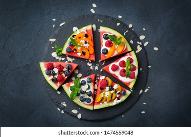 Healthy clean eating, dieting and nutrition, seasonal, summer concept. Watermelon pizza with berries, fruits, yogurt, feta cheese on a table. Top view flat lay copy space background.