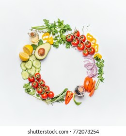 Healthy clean eating layout, vegetarian food and diet nutrition concept. Various fresh vegetables ingredients for salad on white table background, top view, round frame