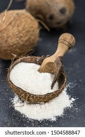 Healthy Coconut flour on a vintage slate slab (close-up shot; selective focus)