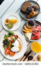 Healthy and colorful breakfast in a cafe. Poached eggs with toast and fruit platter