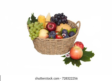 Healthy concept. Fresh fruit rustic bascket.  Apple, pears, plums, grapes, corn.