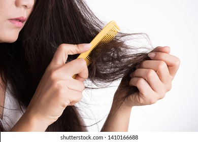 Healthy concept. Woman show her brush with damaged long loss hair and looking at her hair.