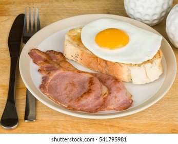 Healthy Cooked Breakfast of Bacon and Egg on Toast
