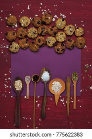 healthy cookies on a bright background with ingredients in wooden spoons