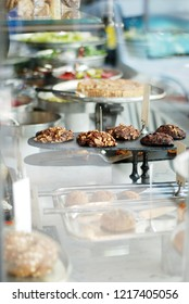 Healthy cookies in a vitrine of a cafe, baked stuff on the plate