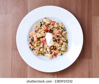 Healthy couscous with cucumber, tomatoes, dried tomatoes, red onion, lemon dresing and greek yogurt