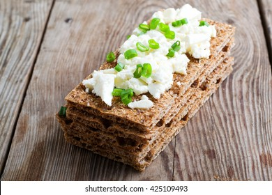 Healthy crisp rye bread with soft cheese,selective focus
