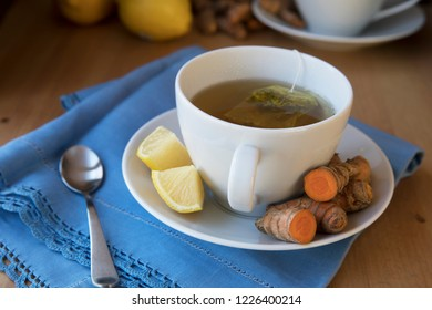Healthy cup of hot turmeric tea with lemon
