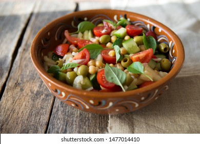 Healthy and delicious bowl  salad of chickpea, fresh tomato  and basil leaves. Vegan and vegetarian dish. Top view. Flat lay