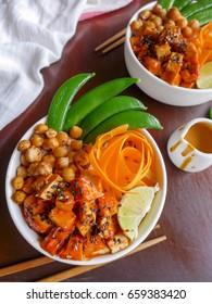 Healthy and delicious homemade vegetarian meal / Vegetarian Buddha Bowl / Made from fresh produce,carrot,sweet pea,spicy tofu,sesame seeds,ground peanut,portobello mushroom,bread crumbs,lemon juice