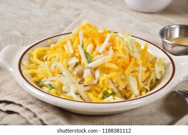 Healthy delicious salad of julienne mango and jicama with cabbage.