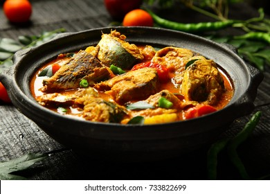 Healthy and delicious seafood curry dish on a rustic wooden table.