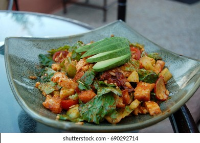 Healthy and delicious southwestern salad topped with slices of avocado