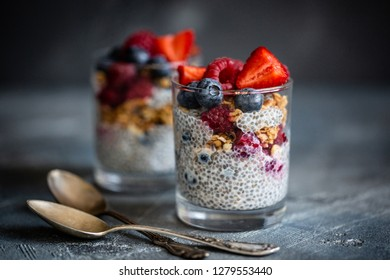 Healthy dessert with chia seeds, blueberries, strawberries, raspberries and granola. Detox and dieting food.