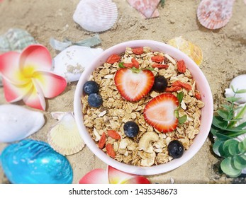 Healthy dessert. Dessert for losing weight containing strawberry, blueberry, yogurt, granular, chia seeds cashew nuts and goji berry.