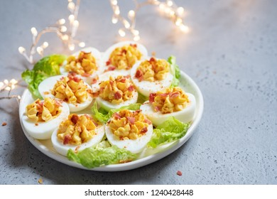 Healthy Deviled Eggs as an Appetizer with Bacon