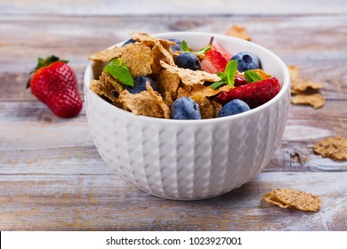 Healthy diet breakfast - oatmeal flakes and berries. Fitness, sport or healthy lifestyle concept. Copy space
