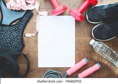 Healthy and diet concept, sport equipments and clothing for woman with white blank sheet, Flat lay