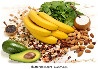 Healthy diet eating concept. Products containing magnesium on wooden background.