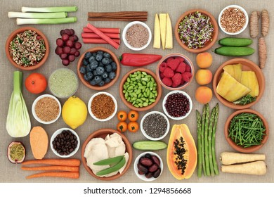 Healthy diet food concept including fish, meat, grains, seeds, coffee, supplement powders, fruit, vegetables & spices. High in antioxidants, protein, anthocyanins, vitamins & dietary fibre. Top view.