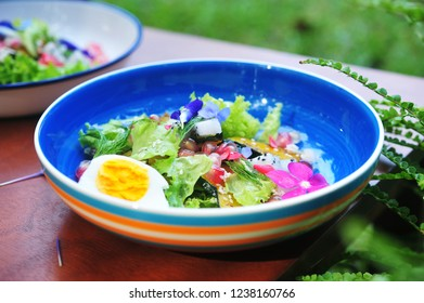 Healthy diet food concept.Fresh salad with grilled pumpkin ,eggs and lettuce.