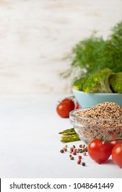 healthy diet food. quinoa in a glass bowl, cherry tomatoes, asparagus, broccoli on a light background concrete