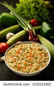 Healthy diet food - Traditional chicken noodle soup served ceramic bowl. Asian recipe.