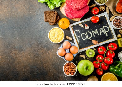 Healthy diet food. Various low fodmap ingredients selection - meat, vegetables, berry, fruit, grains, Trendy healthy lifestyle concept. On dark rusty background copy space top view
