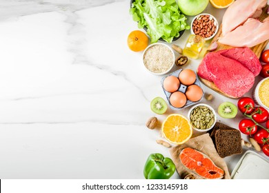 Healthy diet food. Various low fodmap ingredients selection - meat, vegetables, berry, fruit, grains, Trendy healthy lifestyle concept. On white marble background copy space top view