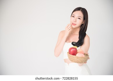 Healthy, Diet, Healthcare fruits or food Concept - Beautiful happy asian woman hold the bowl of fruits with smile isolated on white background.