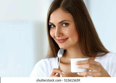 Healthy Diet And Nutrition. Close-up Beautiful Sexy Smiling Young Woman Eating Natural Yogurt. Portrait Of Happy Girl Tasting Organic Yoghurt, Dairy Product. Weight Loss Food Concept. High Resolution