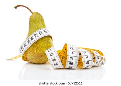 healthy diet; pear with measure tape over white background