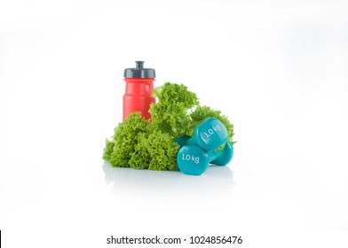 Healthy, diet set. Red plastic bidon with couple of blue dumbbells and tape measure