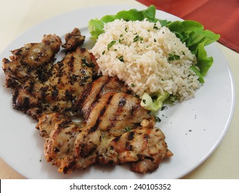 healthy dinner of rice and grilled chicken thigh