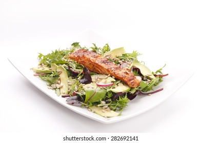 Healthy dinner with salmon and salads on white background