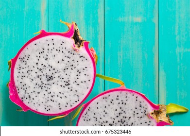 Healthy dragon fruits on wooden background,Dragon fruit on wooden background close up with copy space